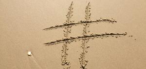 Capitol Compliance Management blog - Banned hashtags beach sand social media instagram business marketing digital cannabusiness cannabis marijuana 420 weed